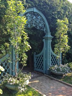 What an incredible vintage iron design. Those are big trees to be growing in those pots. Pinned from fifth state blog.