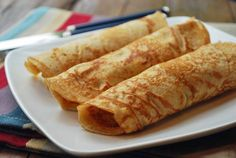 Pannenkoeken (literally translates to pancakes) are Dutch pancakes. They are very similar to French crepes, but they are thicker and sturdier and usually served rolled up, with just a sprinkling of sugar.