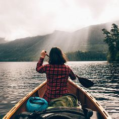 Canoeing at Vancouver Island with the sun rays peeking through the clouds