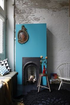 The blue fireplace catches my eye first, then I look at the decoration on it, and then the pillows because of their interesting pattern.
