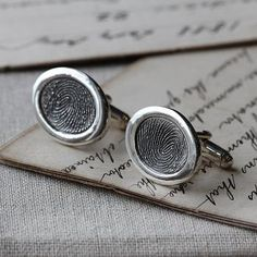 Inked OVAL Fingerprint Cufflinks - Oxidised Silver Fingerprint cufflinks handmade with your loved ones fingerprints. These Oval Cufflinks are designed to highlight the uniqueness of your fingerprints- simply- without the addition of names.