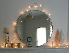 Fairy lights around mirror.