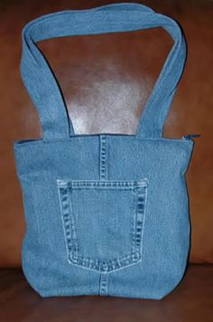 Denim Tote - the one thing I am noticing is that these as 'reuse' the pockets, but if you cut some 'new' pockets, you'd be able to get more than one bag out of your jeans. Just use one of the pockets you used for the earlier project as your pattern.
