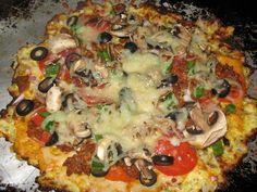 Cauliflower Pizza Crust! We tried this last night, and it's been our favorite gluten-free crust so far. We tripled the recipe and mixed our seasoning into the dough, instead of just sprinkling it on top. It's best if you keep it thin and the toppings to a minimum, otherwise it won't stay crisp.