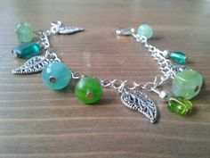 Handmade Jewellery - Bracelet gift idea by Ami Bonser found on MyOwnCreation: A silver plated chain bracelet with green glass beads and silver leaf charms.Measures approx 18.5cm