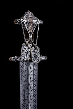 Odin and Fenrir Viking dog tags with a Vendel inspired Viking sword - custom made.