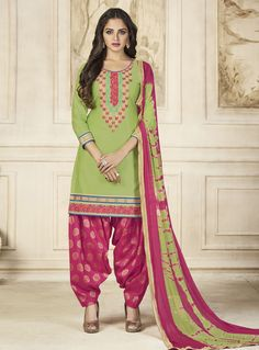 6d2cd4740b This green cotton designer patiala suit is accenting the gorgeous feeling.  This attire is encrafted with embroidered and resham work.