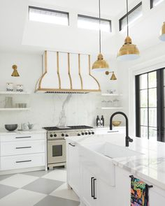 White Kitchen with gold accents. Family room remodel turned into stunning kitchen. designed by Ali Budd PHOTOGRAPHY BY STEPHANI BUCHMAN