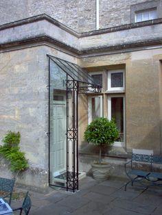 Beech glass and wrought iron door canopy, ironart , bath Glass Porch, Glass Front Door, Glass Roof, Home Porch, House With Porch, House Front, Front Porch, Porch Canopy, Door Canopy