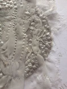 Amy Kelly ARTS THREAD Profile | A project inspired by Organisms and Detritus, Encasing layers of fabric between different weight plastics with a range of melting and Embroidery techniques. Adding small elements of hand Embroidery and other methods to create intriguing areas of surface relief.