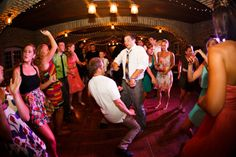 guests dancing at mayowood stone barn wedding reception | Photo: Janelle Elise Photography