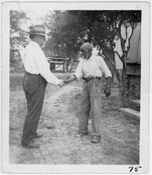 John Lomax, visiting with Alabamam nusician Uncle Rich Brown in 1940. Lomax is credited to saving