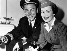 The US actors Jane Wyman and Howard Keel, in a scene of the film Three Guys Named Mike, directed by Charles Walters; the actress interprets the role of an air hostess who falls in love with three men whose name is Mike. Hollywood Icons, Golden Age Of Hollywood, Classic Hollywood, Howard Keel, Jane Wyman, Hollywood Pictures, Classic Actresses, Guy Names, Movies Showing