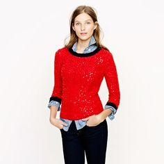 The red sequin sweater with a chambray blue gingham plaid shirt would look cool because red and blue look great together. Washington winters are very mild and don't require much more than sweaters and scarves. Red is a great winter color.