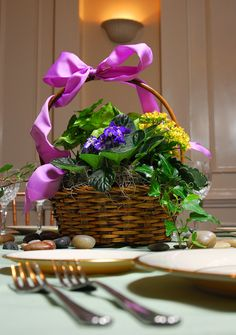 What about a European Garden Basket for a Table Centerpiece? Would make Wonderful Take Home Gifts for Special Helpers after the Wedding.  http://busseysflorist.com/wedding-flowers/