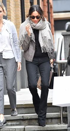 The girlfriend of Prince Harry was wearing shades, tight black jeans, boots, and a grey jacket and matching wrap-around scarf