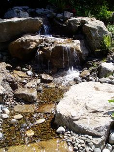 Natural Looking Water Fall.  (Design & Install By McQuiggin's Inc)