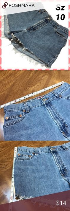 High rise jean shorts Frayed edge.  See measurement pics for sizing info. Distressed mark on rear left pocket. Shorts Jean Shorts