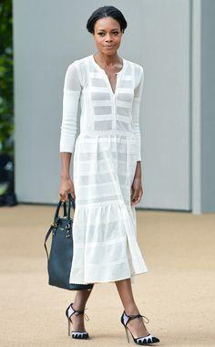 Naomie Harris wears a white dress and black bag by Burberry with Bionda Castana pumps