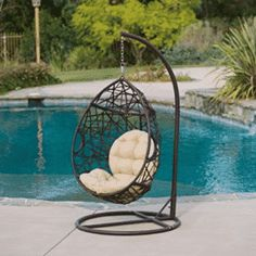 Add a unique touch with this fun Christopher Knight Home Wicker Patio Tear Drop Chair. Built from thick brown meshed wicker, this chair will have you cradled in comfort as you enjoy your backyard or patio, complete with beige cushions for extra comfort. Wicker Swing, Egg Swing Chair, Hanging Egg Chair, Patio Swing, Hammock Swing, Swinging Chair, Swing Chairs, Hanging Basket, Room Chairs