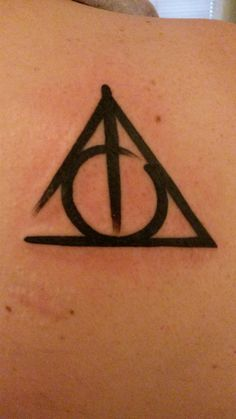 Deathly Hallows tattoo on shoulder