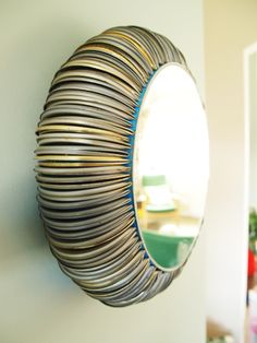 Tin can lid mirror... wow... what a way to recycle!!!