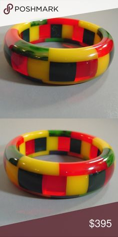 """SHULTZ bakelite special 3-row checked bangle SHULTZ bakelite special 3-row checked bangle in red, green, navy blue, yellow checks, 2-1/2"""" by 1"""" by 1/2"""". Artisan Ron Schultz, who began making his bakelite jewelry in the 1980s, creates his pieces using only genuine vintage circa 1940s bakelite, and every piece is his own original work. It is signed, as are almost all Shultz pieces, and in excellent condition.     B65655 All items in excellent vintage condition unless noted above. SHULTZ…"""