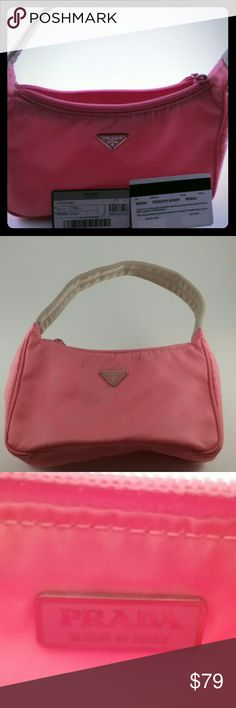 Authentic Prada Tessuto sport handbag Will Trade! This is a cute, nylon prada sport. One of thier lower end  styles, but still Prada.. Its a small, cute bag for summer, days, maybe at the park. Theres one small stain as shown in last photo. It comes with Authenticity Cards.  Priced to sell...A steal! Will Trade for right item! Prada Bags Mini Bags