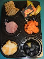 A plastic 12-cup mini-muffin-type tray that had once housed some Trader Joes mini quiches. I cut it in half and made a pumpkin patch field trip bento.