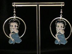 Betty Boop Dangle Hoops: Betty in brightly colored evening dress perched on a large circular hoop. Available in Blue, Red, Bright Pink, and Deep Pink (Fuschia). Thanks for looking!