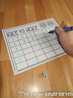 """Build Kindergarten Number Sense with these 20 differentiated centers! In """"Race to Trace,"""" students roll and write numbers practicing identification and formation of numbers."""