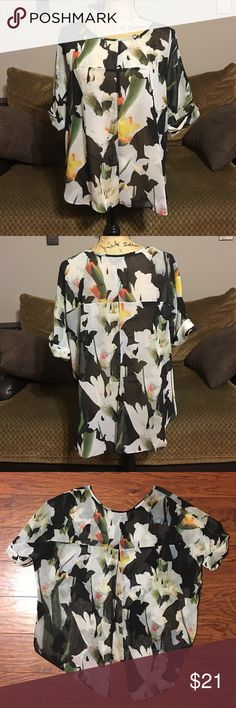 """TopShop Blouse Beautiful floral print sheer TopShop Blouse. Has split open back. 100% polyester. Size 4, medium. Measures 24"""" armpit to armpit. Made to fit a bit large. Gorgeous worn over a black tank top. Topshop Tops Blouses"""