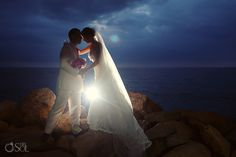 Mexico Wedding Puerto Vallarta Sunset Plaza, newlyweds in an intimate moment on the coast.  Mexico wedding photographers Del Sol Photography