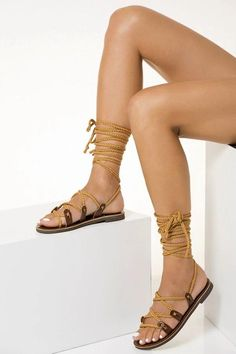 Greek Chic Handmades has designed a complete Summer Collection of leather sandals and leather bags handcrafted in Greece. Almost any flat sandal can be customized to your style. You can just select between our gladiator sandals, slides, ankle wrap sandals, toe ring sandals, open toe sandals and bridal sandals. Pick the leather color you wish and choose from the vast collection of colors among the scarf laces, the silk laces, the braided straps or the leather laces, depending on the design.