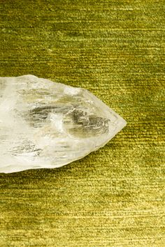 A Himalayan crystal resting on one of my silk rugs, handwoven in the Himalayas. #carpetswithsoul #josephcarinicarpets #himalayas #himalayancrystals #crystals
