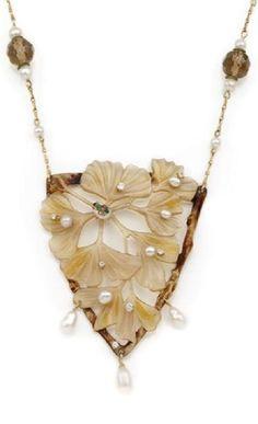 An Art Nouveau gold, horn, diamond, pearl and smoky quartz necklace, French, circa 1900. Pendant: 8.3 x 5.5cm.