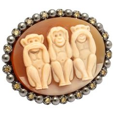 Preowned Amedeo Monkeys Cameo Ring With Yellow Sapphires ($3,000) ❤ liked on Polyvore featuring jewelry, rings, fashion rings, yellow, carved rose ring, cameo rings, yellow jewelry, handcrafted rings and preowned rings