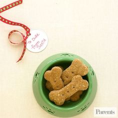 Treat your puppy to tasty gingerbread snacks.                 1. Heat oven to 325 degrees F. Combine 3/4 cup hot water and 1/4 cup butter in a large bowl. Stir until butter melts. Add 1/2 cup powdered milk, 1 teaspoon salt, and 1 large egg, beaten. Stir in 2 cups whole wheat flour, 1 cup quick oats, and 1/4 cup wheat germ. Mix until dough forms. Knead on a floured surface to form a stiff dough.                 2. Roll dough out to a 1/2-inch thickness and cut out dog-bone shapes using a…