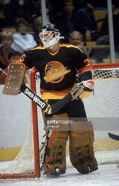 Canadian professional ice hockey player Richard Brodeur, goalie of the Vancouver Canucks, guards the goal during a road game, Brendan Byrne Arena, East Rutherford, New Jersey, 1980s. Brodeur played with the Canucks from 1980 to 1987.