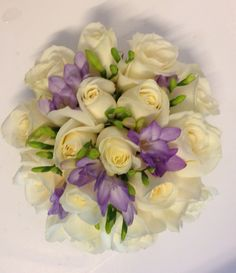 Bridesmaids bouquet in lilac fressia and Ivory roses