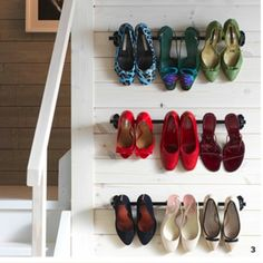 Using curtain rods as shoe racks - from the IKEA Catalogue.