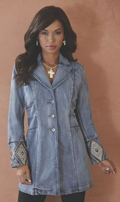 Rich embroidery, embellished with rhinestones, impart a sense of the Southwest to this denim duster.
