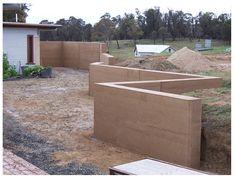 Rammed earth retaining/fence walls...  http://www.rammedearthnational.com.au