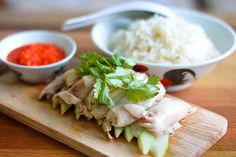 Facebook Twitter Google+ PinterestChicken rice, or Hainanese chicken rice, is a dish which originated in the Hainan province in southern China. Considered one of Singapore's national dishes, chicken rice is also popular in Malaysia, Thailand and Vietnam. To make this flavourful meal, you need to poach a whole chicken and serve it over steamed rice