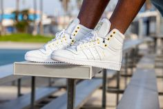 This season's return of the Top Ten Hi from adidas Originals started with release of the 1979 era sneaker in its original colorway. The basketball sneaker Basketball Sneakers, Vans Sneakers, Converse, Adidas Originals Tops, The Originals, Adidas High Tops, Run Dmc, Sneaker Magazine, Top Ten