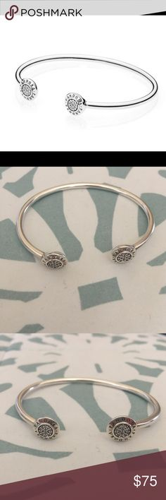 Pandora signature bangle 100% Authentic Pandora Signature bangle.  This is a size Small.  This item was originally purchased at the Pandora Store at Southpark Mall in Charlotte, NC.  It's only been worn a few times.  In great condition. Pandora Jewelry Bracelets