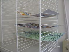 Easy and Inexpensive Artwork Drying Rack, Covered Wire Storage shelves turned sideways. Genius!