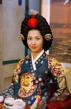 """Dae Jang Geum(Hangul:대장금;hanja:大長今;RR:Dae Jang-geum;MR:Tae Chang-gǔm; literally """"The Great Jang-geum""""), also known asJewel in the Palace, is a 2003 Korean television series.StarringLee Young-aein the title role, it tells the tale of an orphaned kitchen cook who went on to become the king's first female physician. Dae Jang Geum, Lee Young, Korean Drama Movies, Korean Dress, Female Stars, Drama Korea, Different Styles, Kdrama, Palace"""