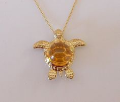 14k Yellow Gold Sea Turtle with a Cabochon Citrine shell.#goldturtle #seaturtlejewerly #citrinependant #seaturtlependant #seathemedjewerly # seaturtle #turtleneckalace #goldturtlenecklace