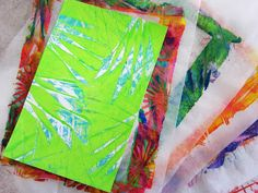 Gelli® Printing with Folded Paper!! TIP:  When creating bleed prints (no borders) — where the paper is smaller than the painted plate — place a cover sheet over the printing paper to keep your hands clean. You can use your cover sheets over and over. Deli paper is an excellent cover sheet, as shown in the video.
